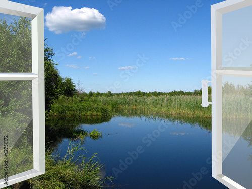 opened window to the lake and meadow