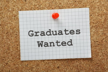 Graduates Wanted sign pinned to a cork notice board