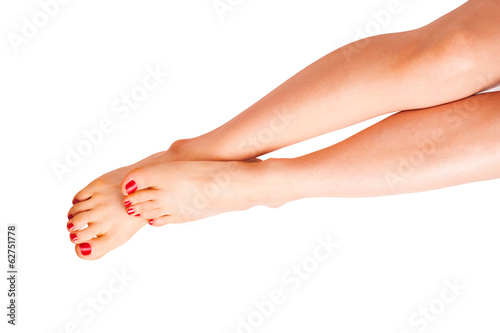 Smooth legs with red nails isolated