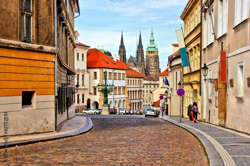 Staande foto Praag Street in the old town of Prague with St Vitus Cathedral