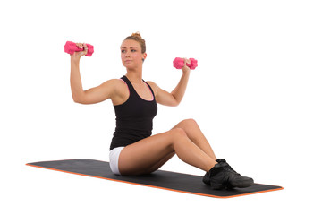 Female exercises shoulders on aerobic mat