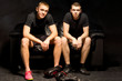 Two young boxers relax before a training session