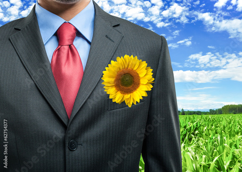 Businessman keeping a sunflower in his pocket