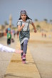 Young girl running on the beach of Caesarea