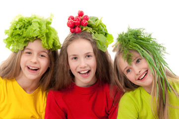 Smiling children with vegetables