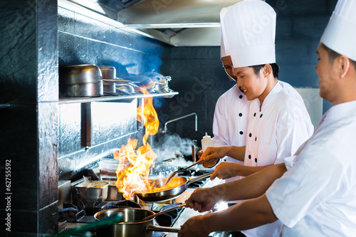 Asian chefs cooking in Restaurant