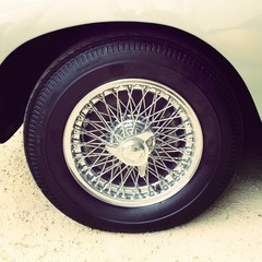 close-up of vintage car wheel, retro style