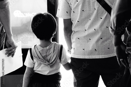 Father and child holdin hand