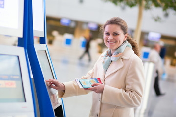 Woman doing self check-in in the airport