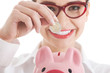Business woman with piggy-bank