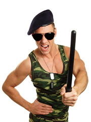 Angry military man at sunglasses with nightstick