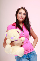 Childish woman infantile girl hugging teddy bear