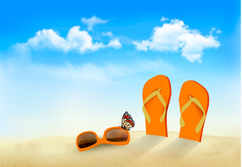 Flip flops, sunglasses and a butterfly on a beach. Summer memori