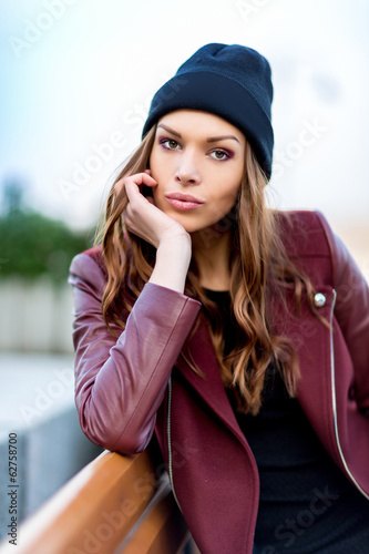 Young woman sitting on a bench.