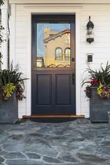Blue door of home in daytime