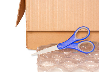 Packing and mailing tools.Box, scissors,bubblewrap.