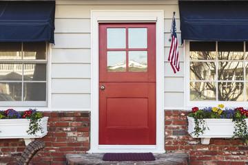 Red front door of an american home