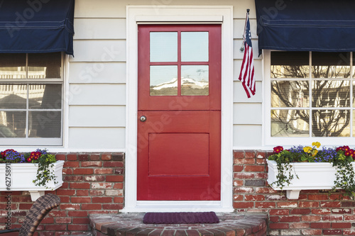 Red front door of an american home