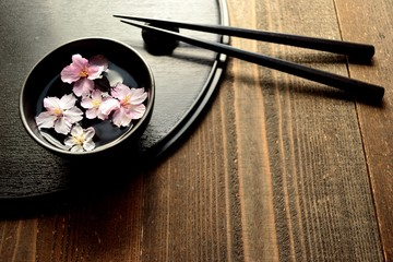 Small bowl of cherry blossoms with chopsticks