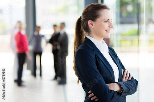 businesswoman looking outside office window