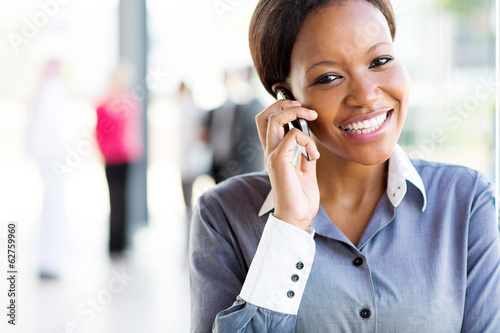 afro american businesswoman talking on cell phone