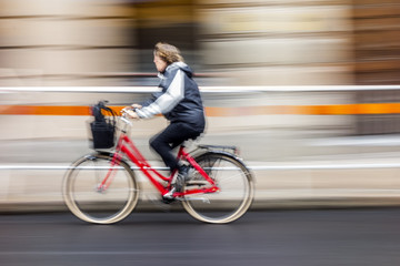 Cyclist in traffic on the city roadway