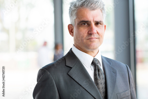 serious senior businessman close up portrait