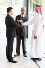translator introducing muslim businessman to business partner