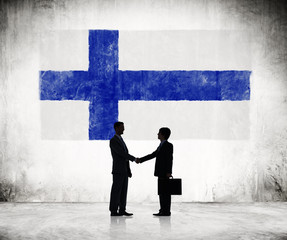 Businessmen Shaking Hands With Flag of Finland