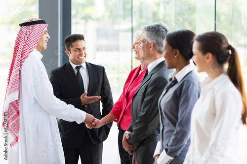 young translator introducing Arabian businessman
