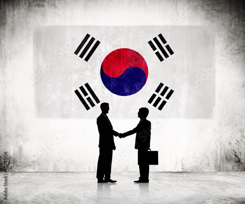 Silhouette of Business Handshake With Flag of South Korea