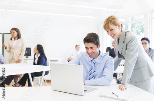 Female Manager Supervising Employee in Office