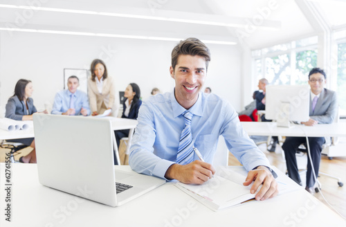 Cheerful Businessman Working In Office