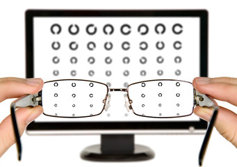 Man is viewing to eye examination chart