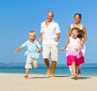 Scandinavian Family Running On The Beach