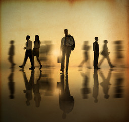 Silhouette of Business People Walking at Sunset