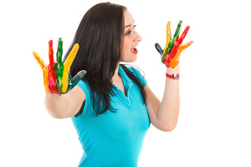 Surprised woman looking to hands in paints