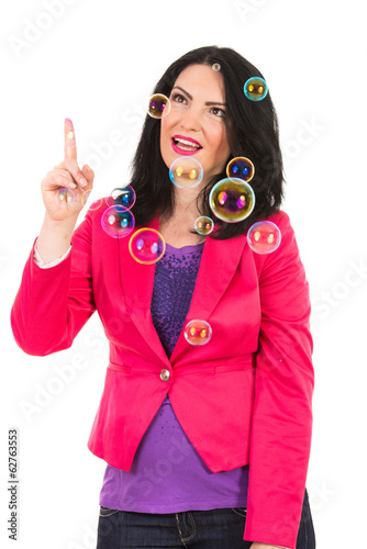 Smiling woman touching bubbles