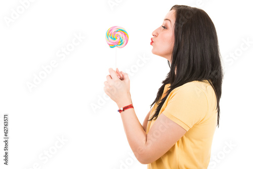 Woman kissing a lollipop