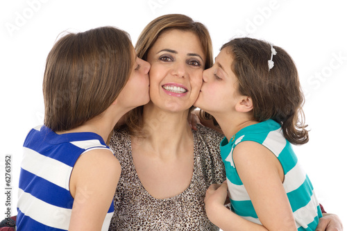 two daughters kissing their mother isolated on white..