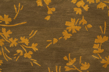Carpet with floral design texture close up