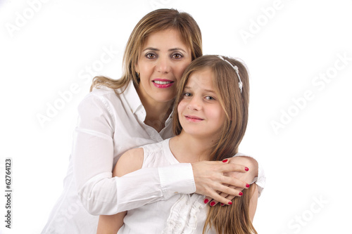 bright picture of hugging mother and daughter..