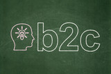 Finance concept: Head With Light Bulb and B2c on chalkboard poster