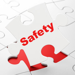 Security concept: Safety on puzzle background