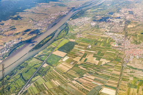 aerial of small village with fields at river rhine