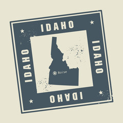 Grunge rubber stamp with name and map of Idaho, USA