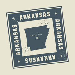 Grunge rubber stamp with name and map of Arkansas, USA