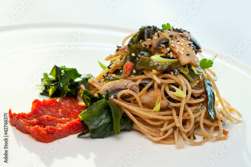 Healthy spaghetti with mushrooms and seaweed.
