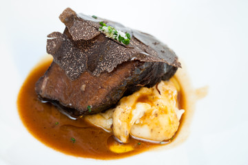Roasted beef with black truffle and mashed potatoes.
