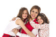 Mother and two daughters hugging in stylish fashionable outfits